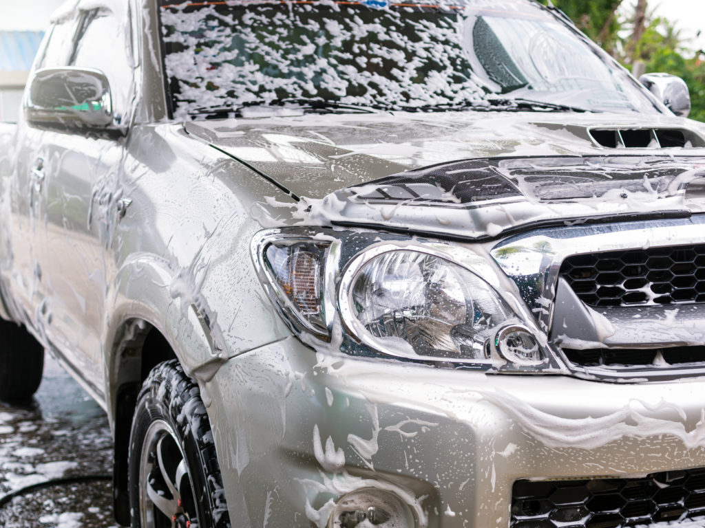 Cleaning the car with foam,car wash shop